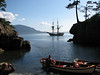 Lady Washington stands off as passengers explore a remote cove of the San Juan Islands. Photo by Grays Harbor Historical Seaport Authority.